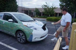Duane plugs in the Nissan Leaf at County Square for a recharge.